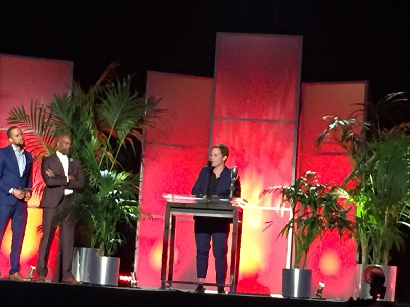 Chris Nee accepting the NAACP award for Doc McStuffins